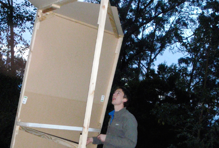 Chris (with very little building experience) struggles to make the structure hold together.