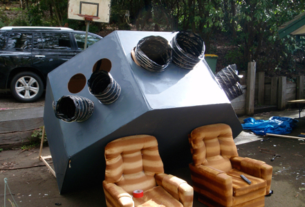 The spaceship structure sits comfortably on a couple of arm chairs.